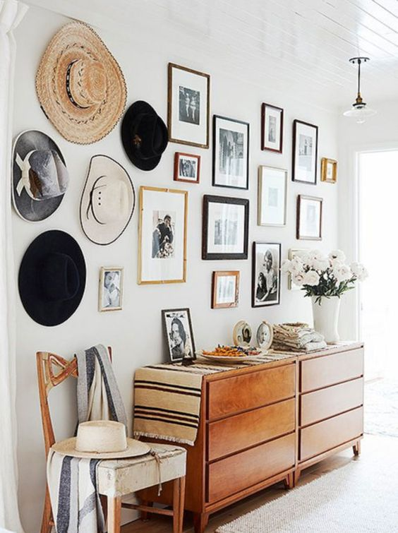 Feature wall with picture gallery and hats