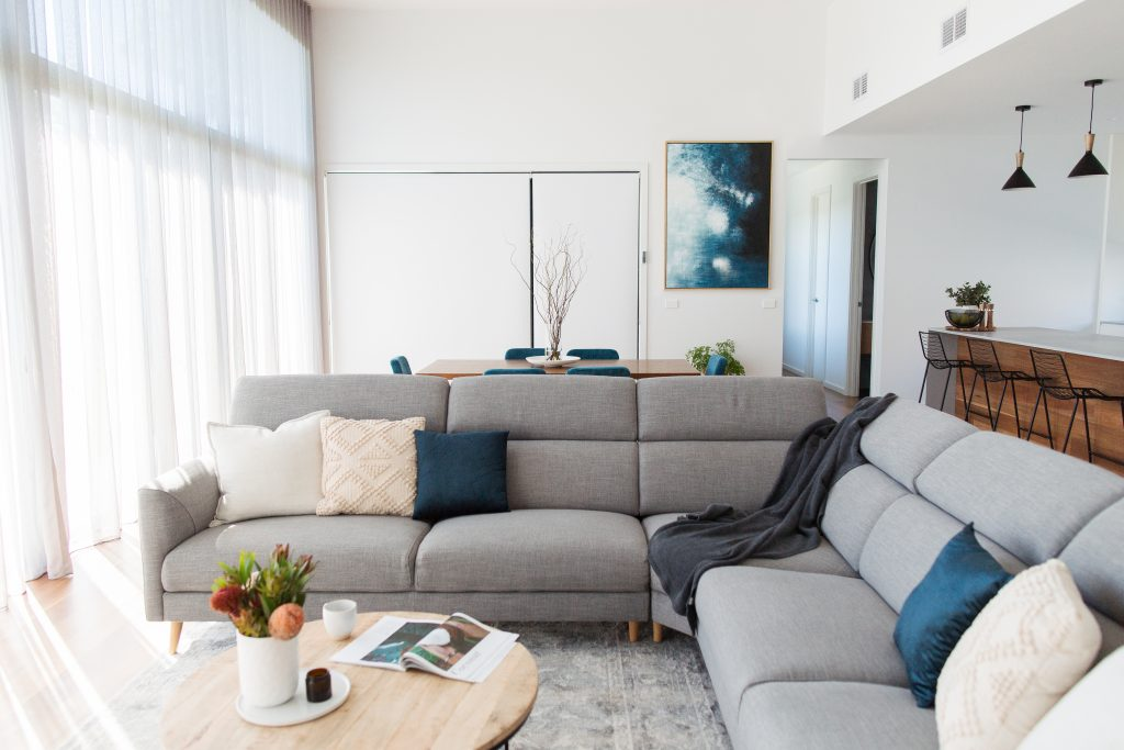 Living room design with colour palette of blues, greens, light grey and white