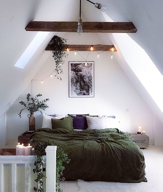 Bedroom with soft lighting, candles and festoon lighting