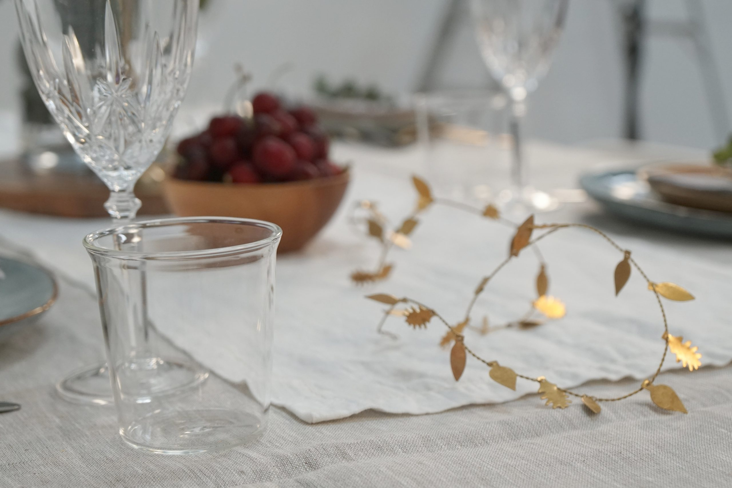 Brass wire Christmas garland on table
